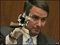 Detective Mark Lillienfeld holds up a Colt Cobra revolver
